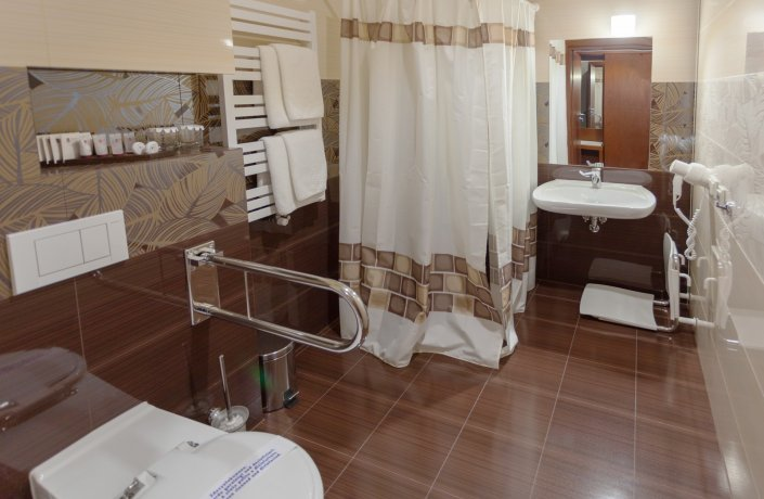 A two-person bedroom with amenities for the disabled